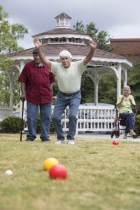 Two men playing Bocce Ball at Wesley Woods Newan