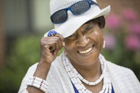 African American Woman with hat and sunglasses