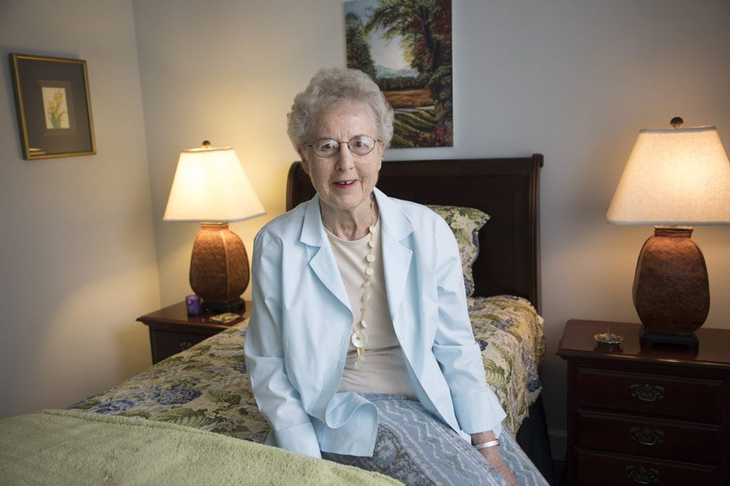 senior lady resident in her bedroom