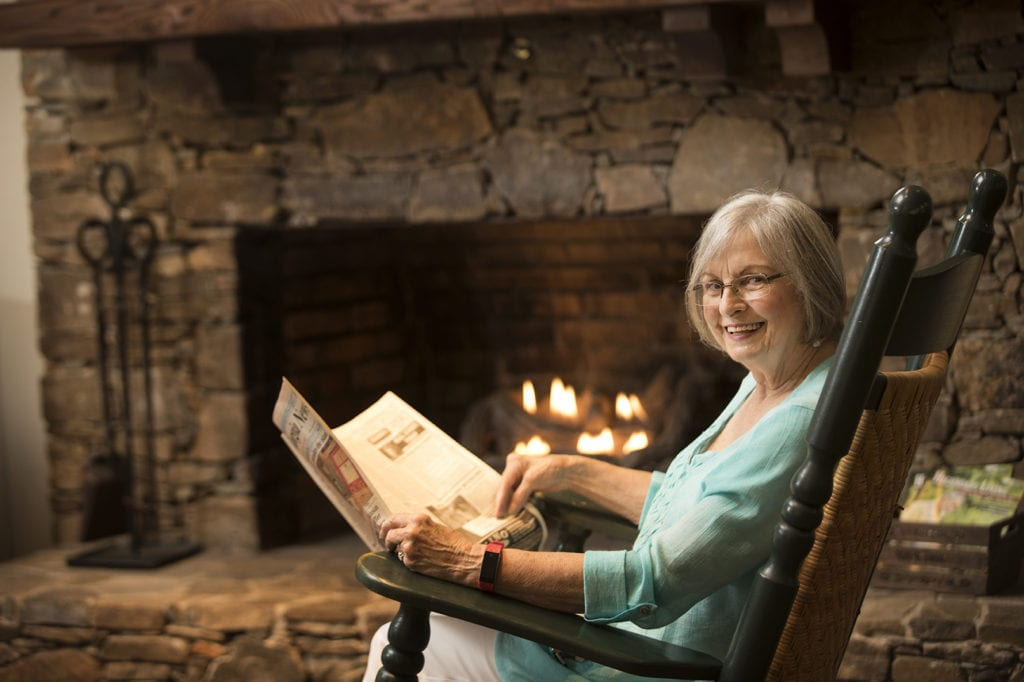 Reading the Paper by the fireplace