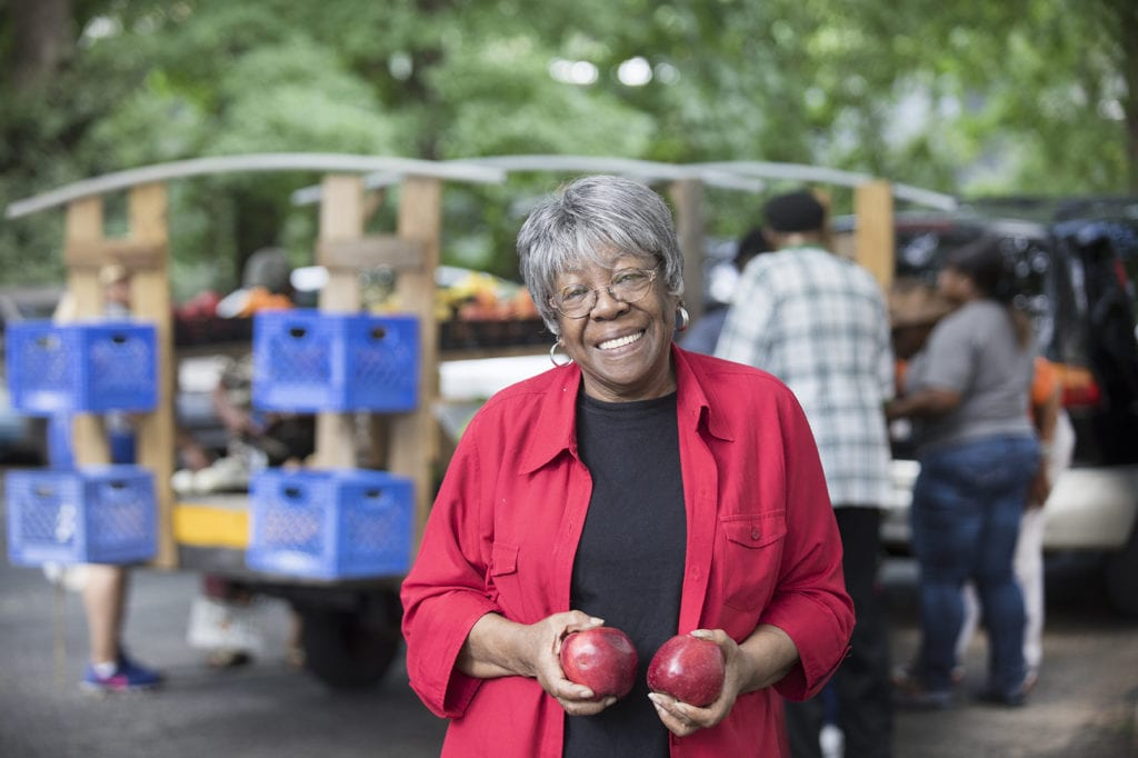 Senior Lady holding red apples